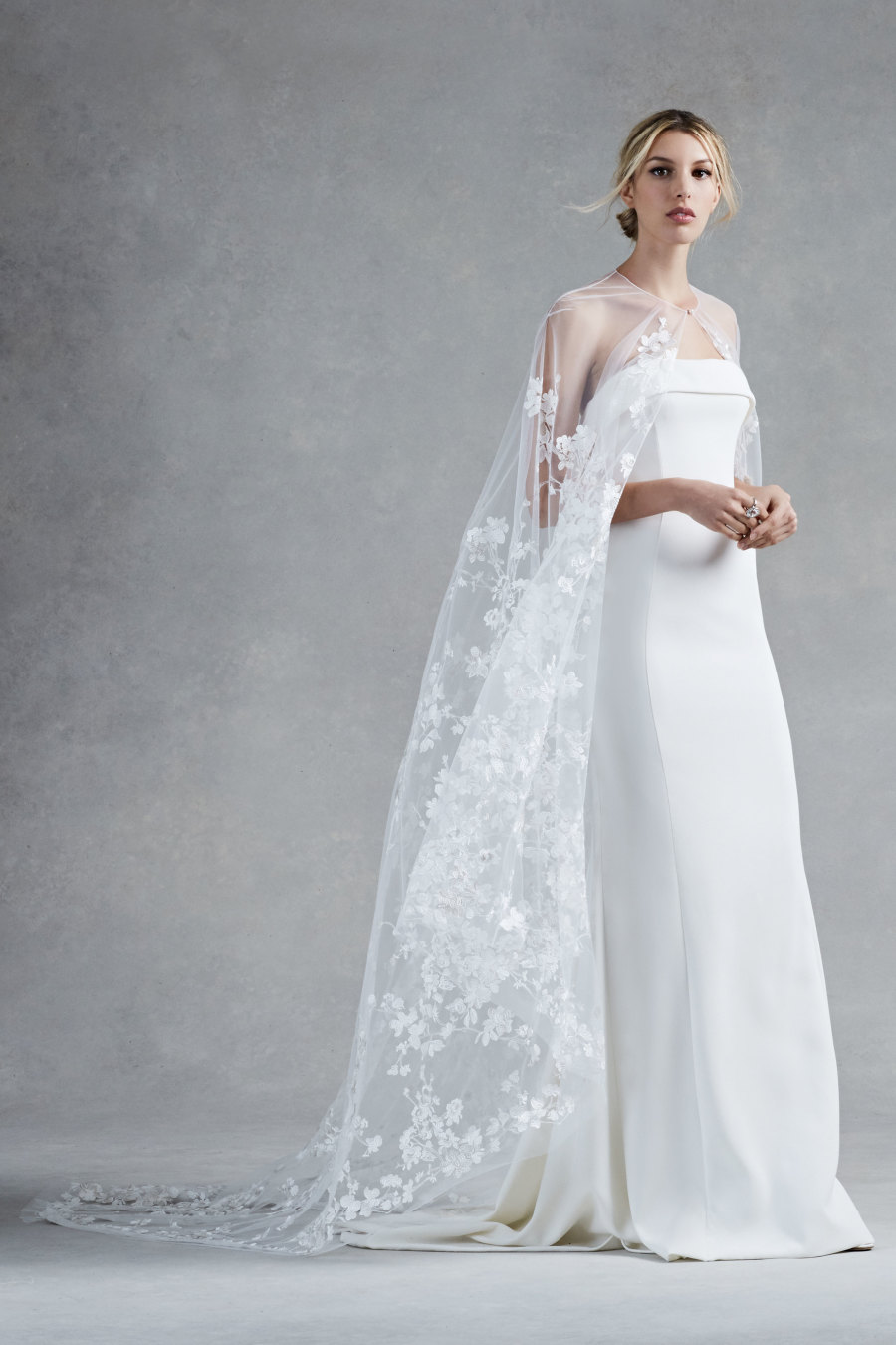 oscar dela renta cape wedding dress
