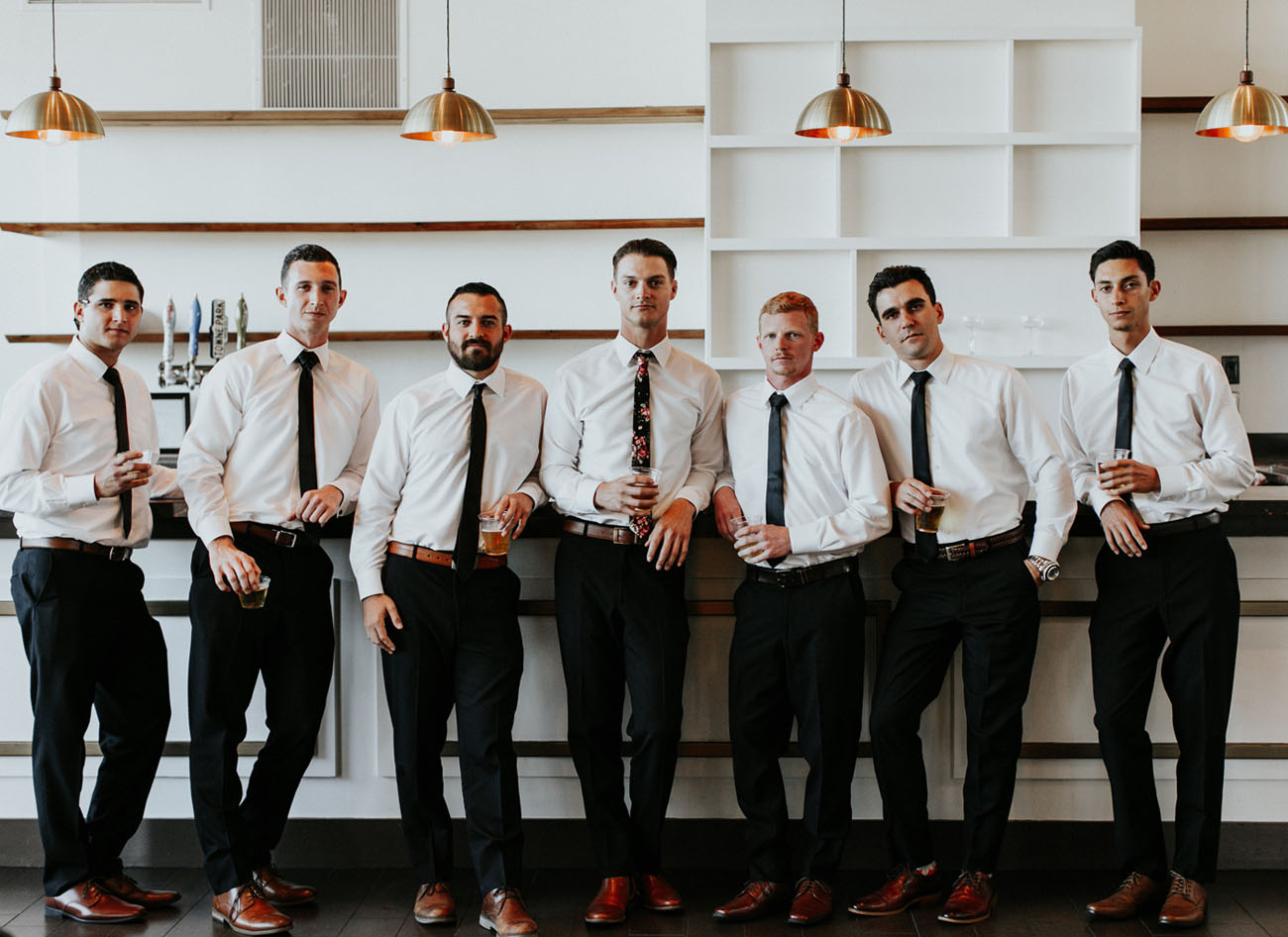 groomsmen with drinks