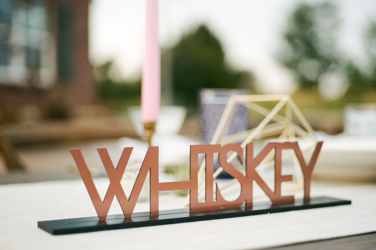 copper whiskey sign