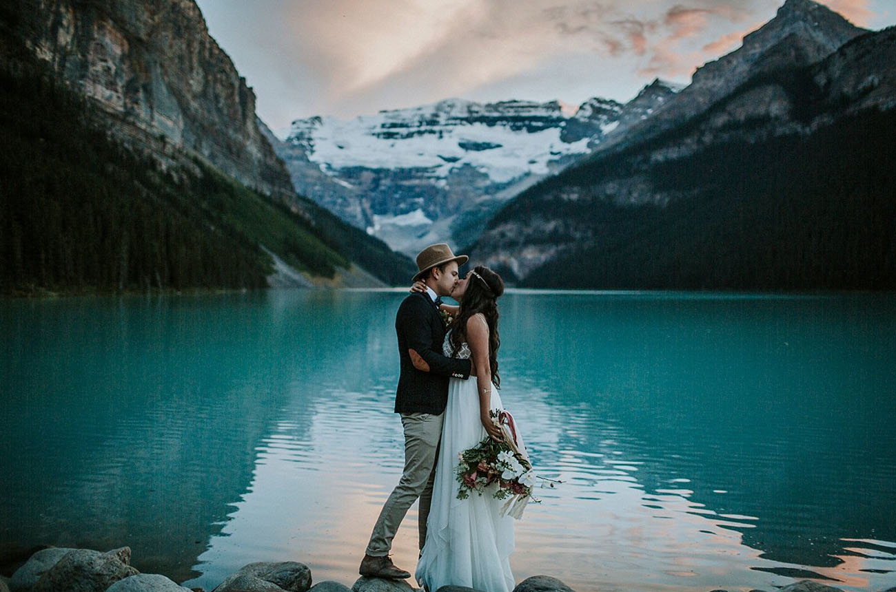 Eloping at the waters edge in Lake Louise Canada is a truly breathtaking spot to get married
