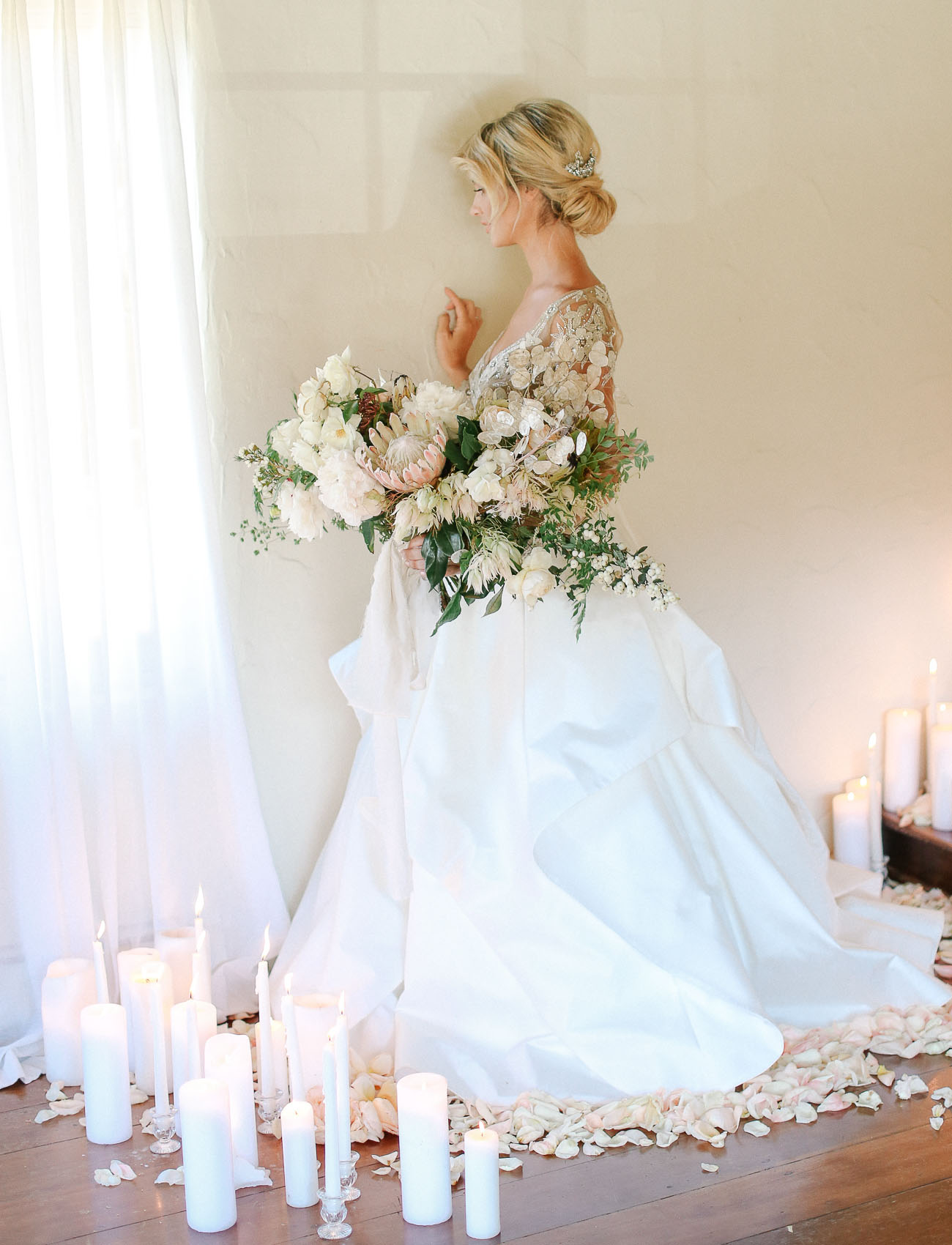 bride surrounded by candles