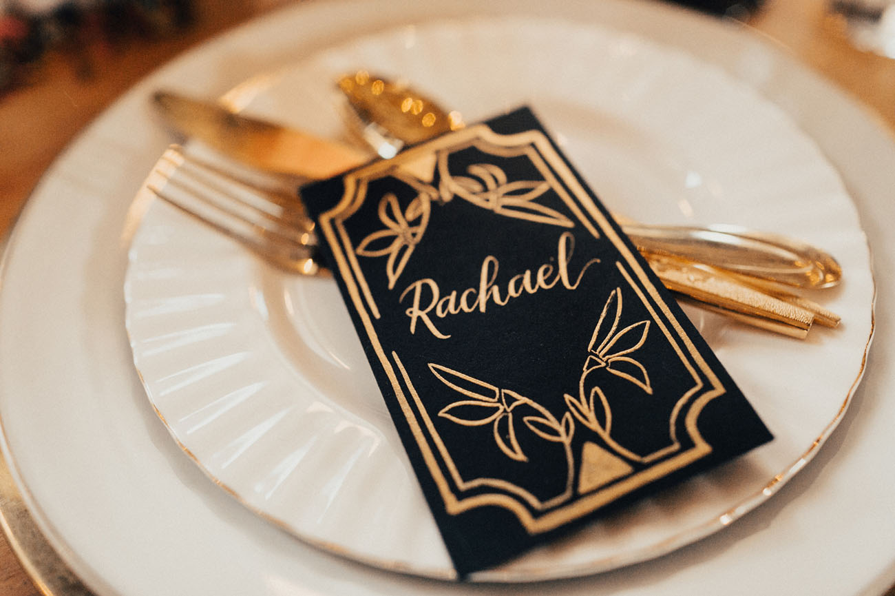 black and gold name card