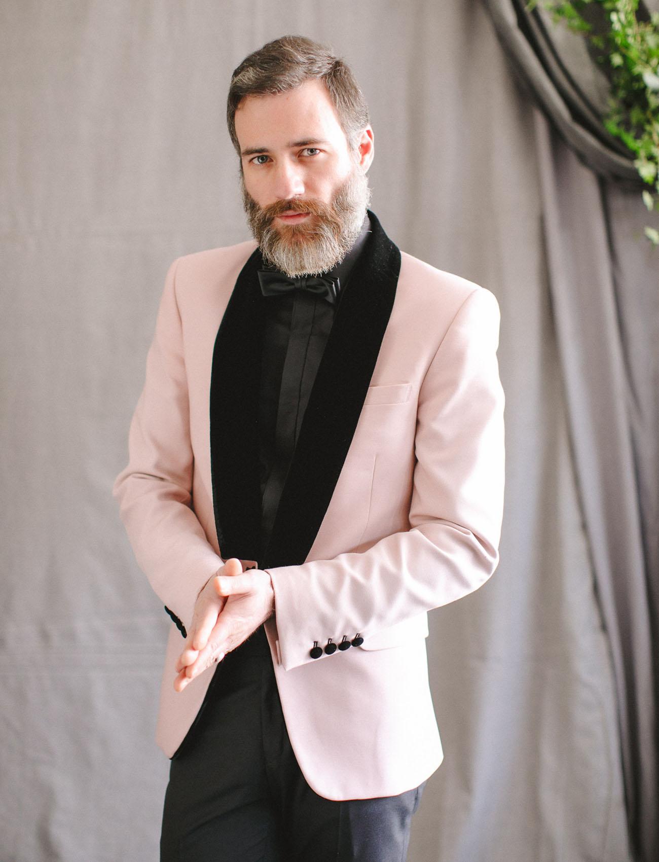 pink suited groom