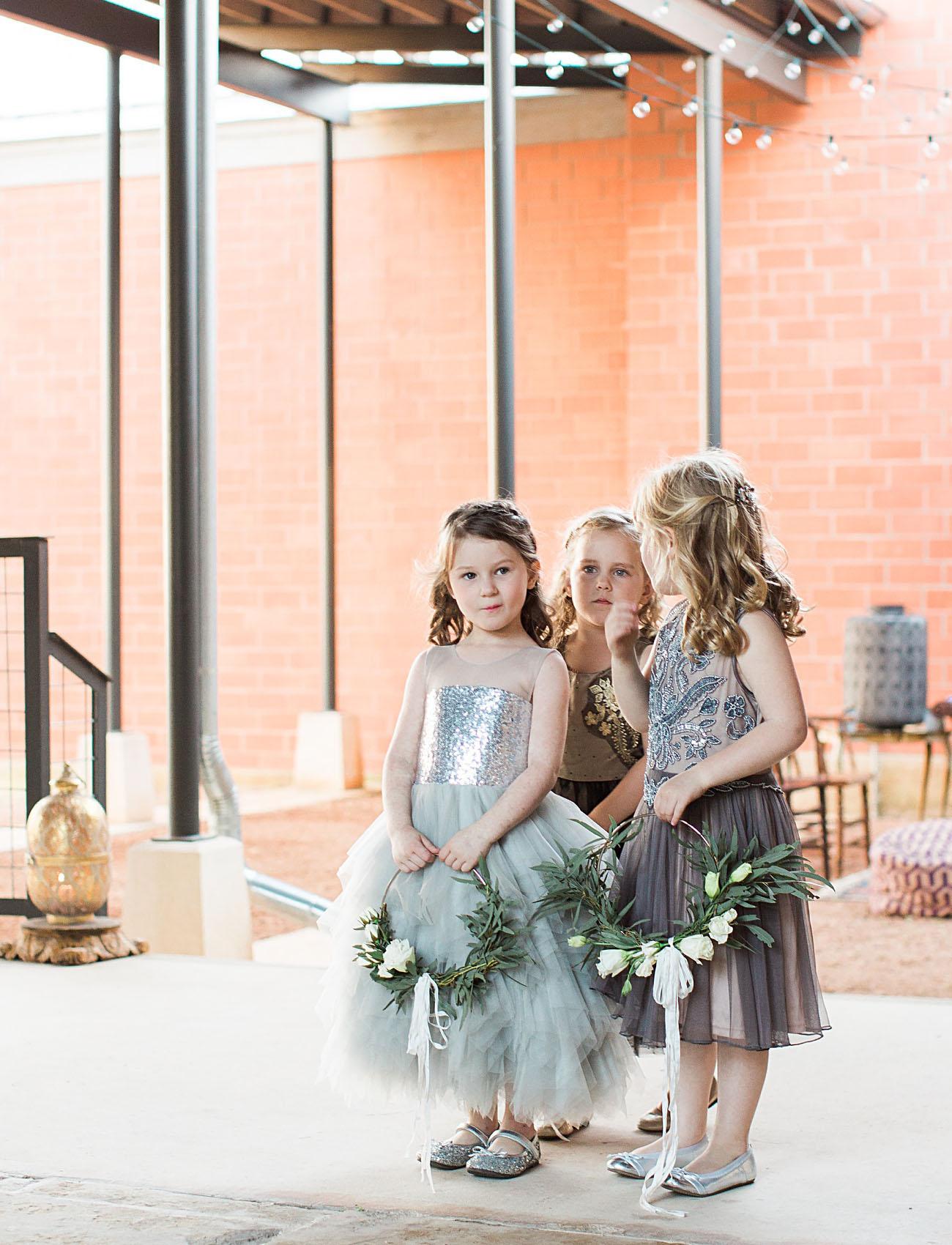 flower girls with wreaths