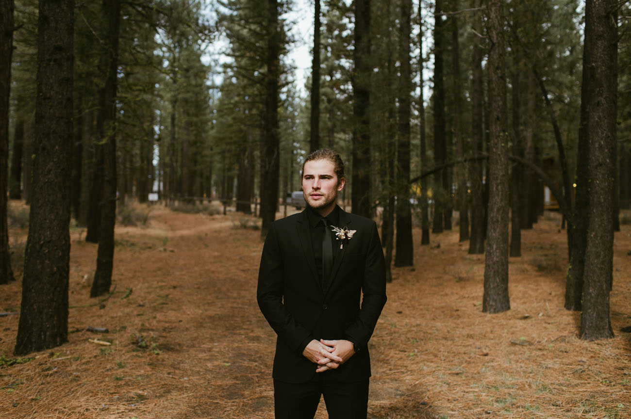 all black suited groom
