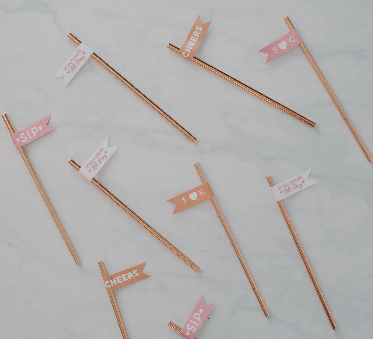 rose gold metallic straws with cheers flags