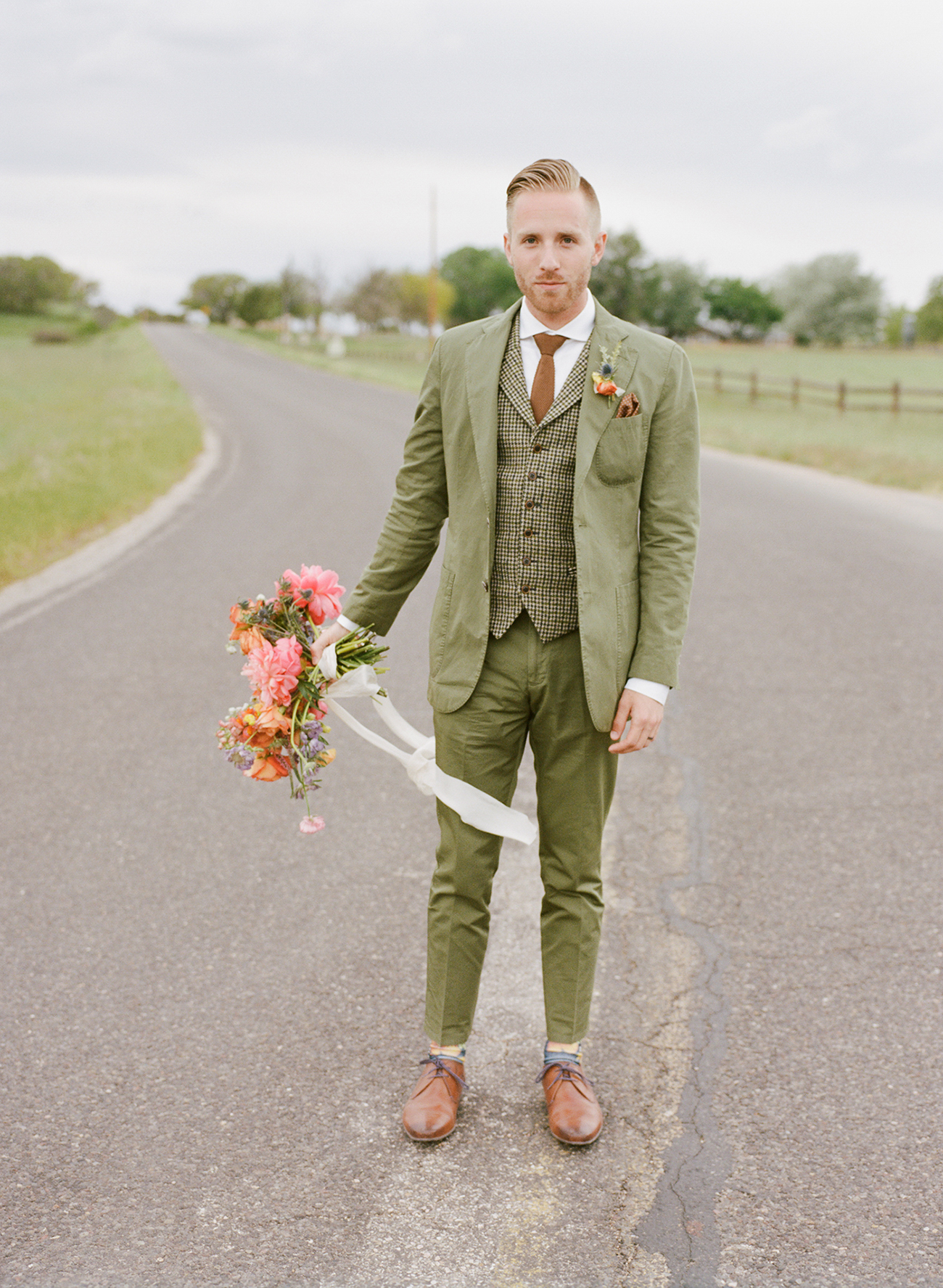 green suited groom