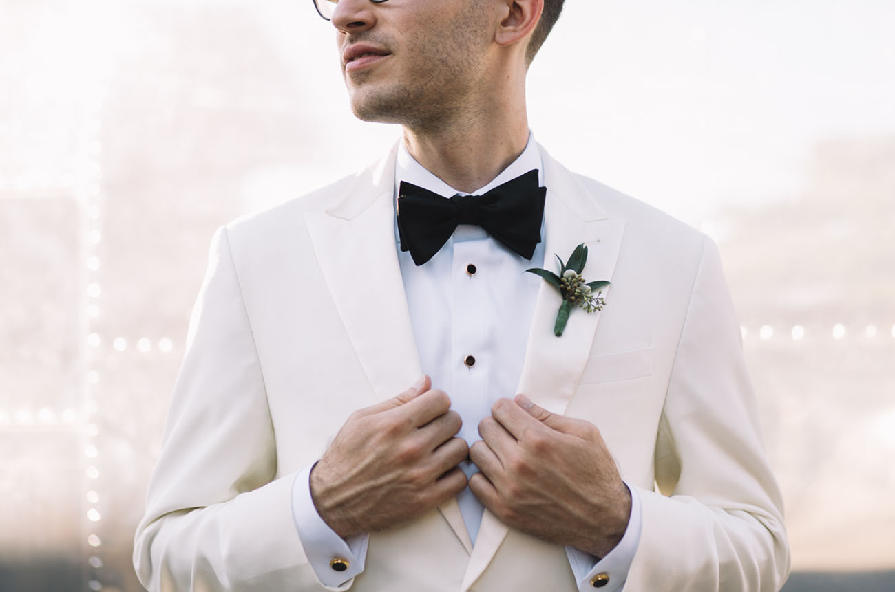 white tux groom