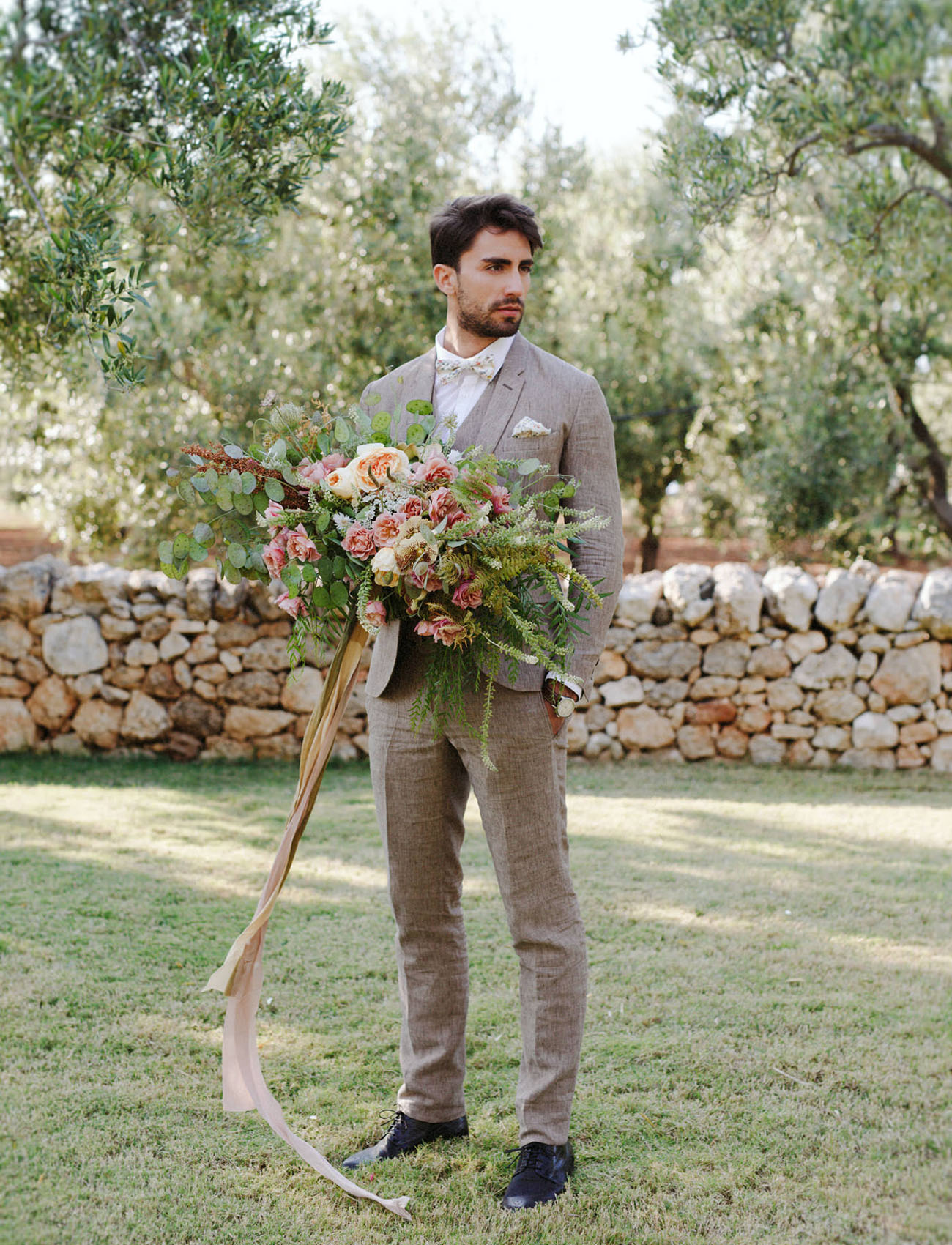 groom with bouqueet