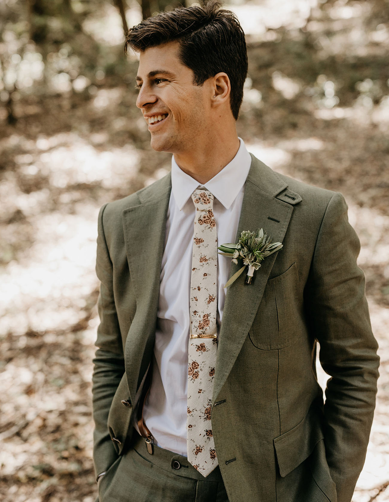 green suit groom