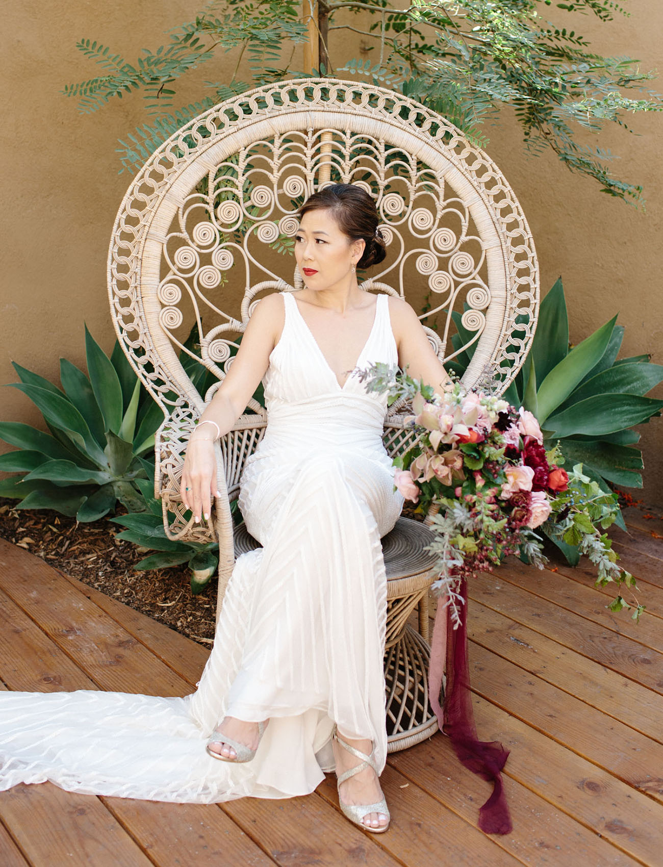 bride in peacock chair