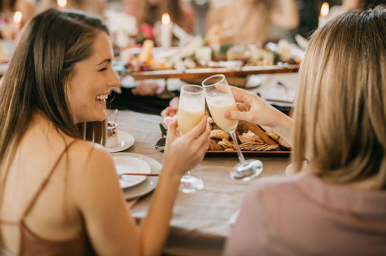 girls toasting at brunch