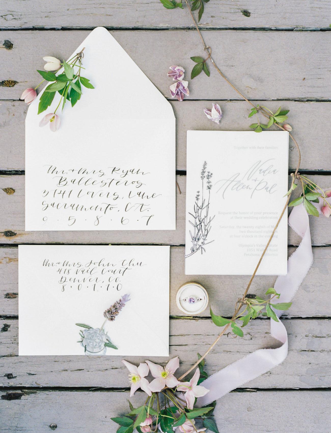 white floral invitation