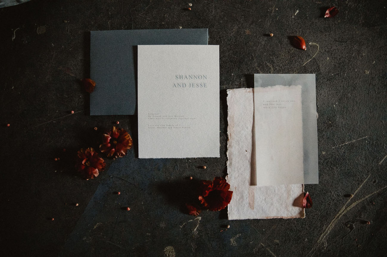 white and navy invitation