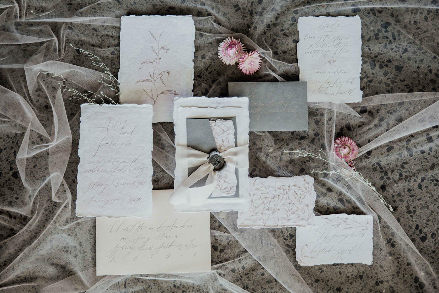 torn paper wedding invitation