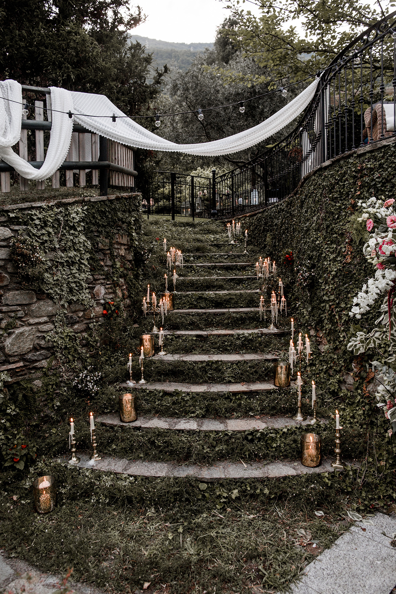 moss filled steps with candles