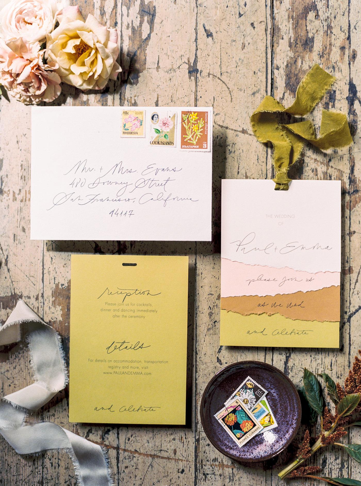 torn paper wedding invitation