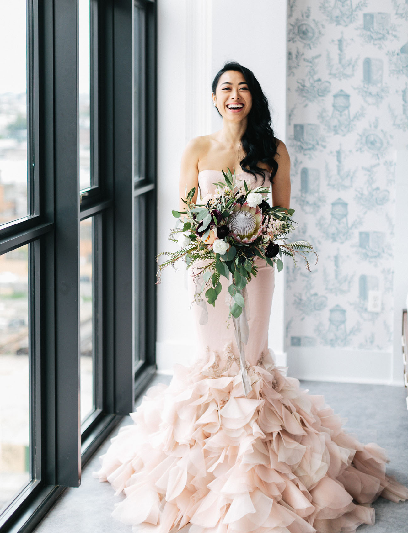 6f10c4857bbc photo: chaz cruz photographers | dress: vera wang | from this: the bride  wore a stunning blush dress at this industrial modern wedding