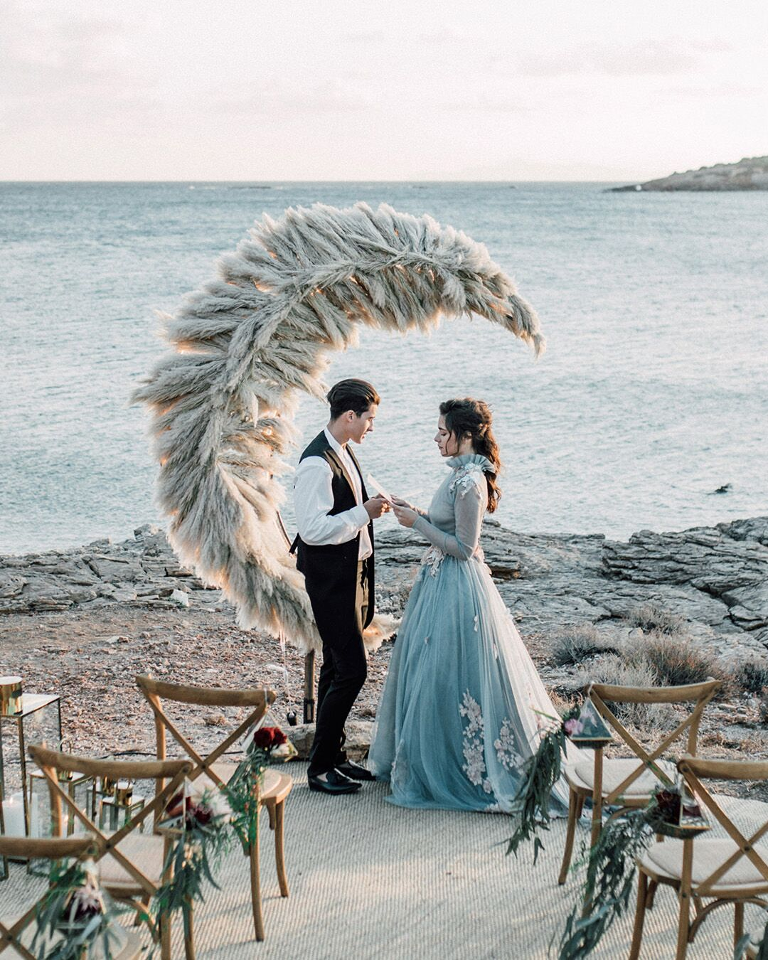 bride in a blue dress and pampas grass crescent moon