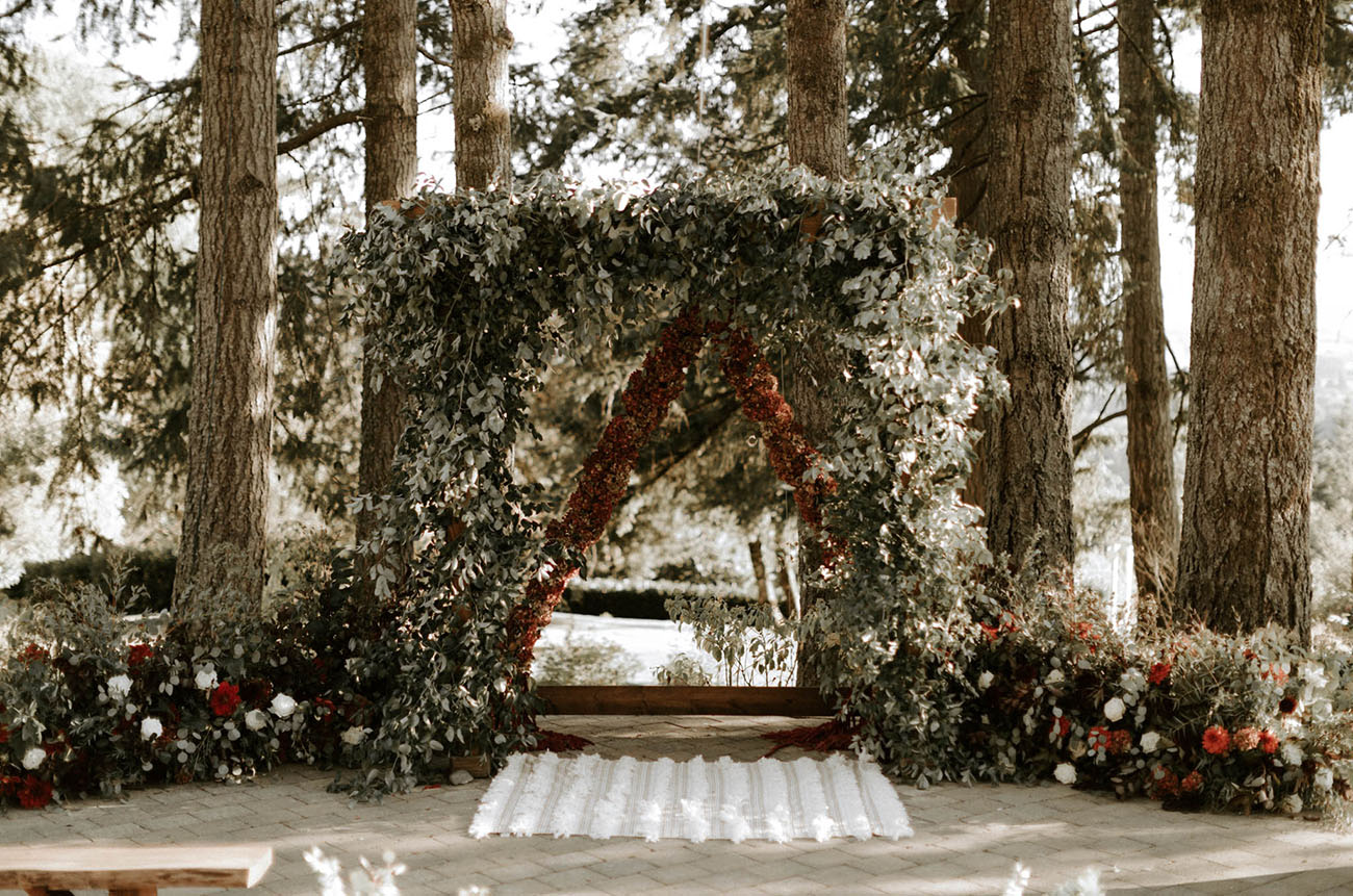 red and green floral arch