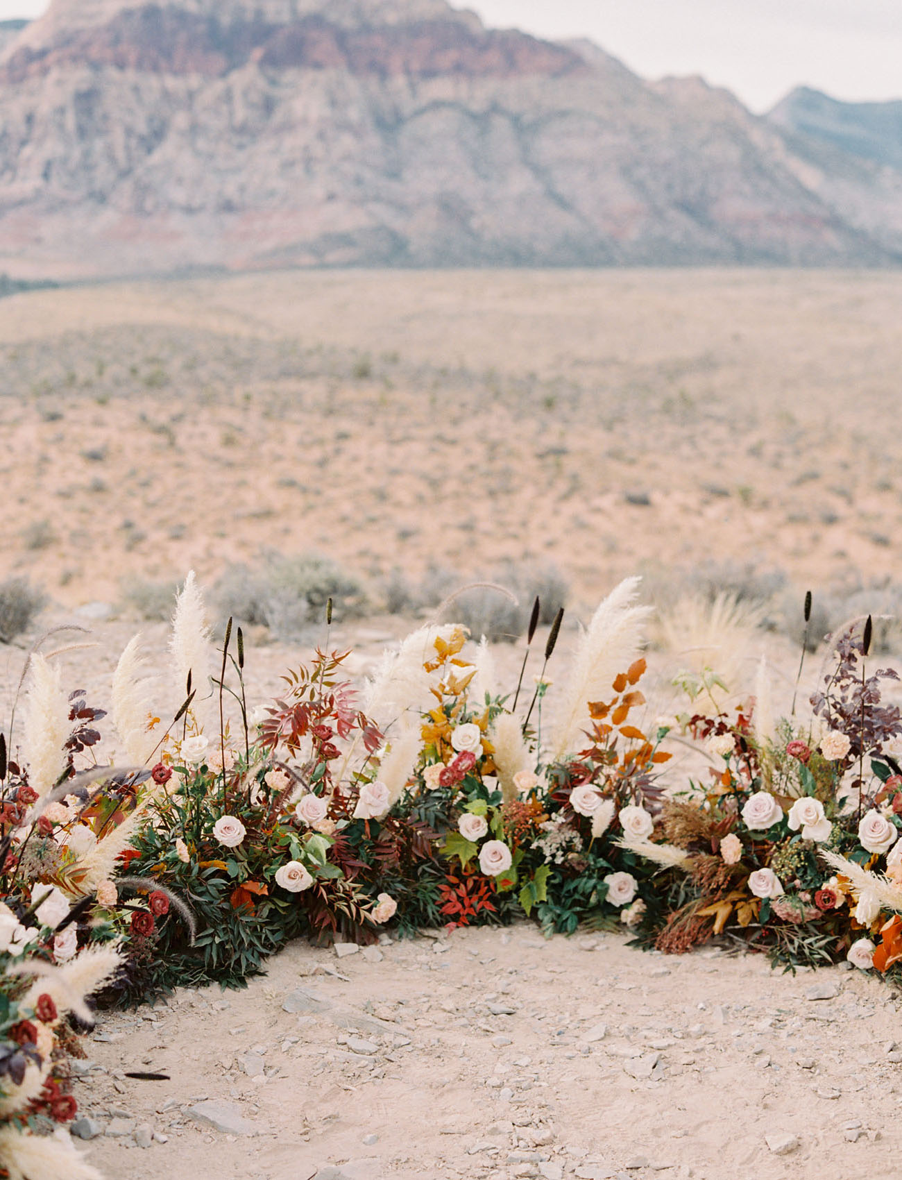 half circle ceremony florals