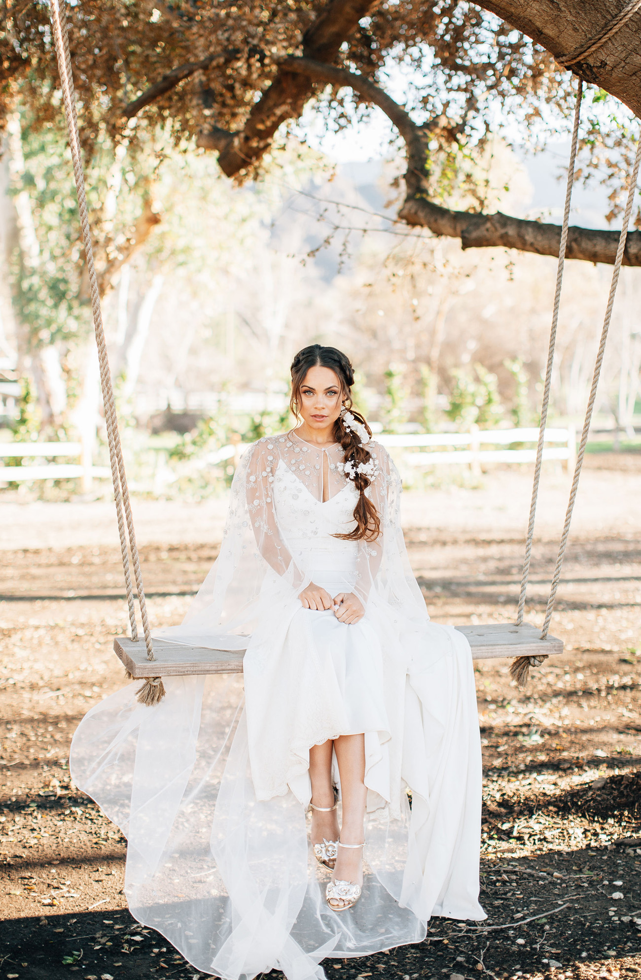 Lovers Society x Green Wedding Shoes Wyatt Wedding Dress paired with a cape