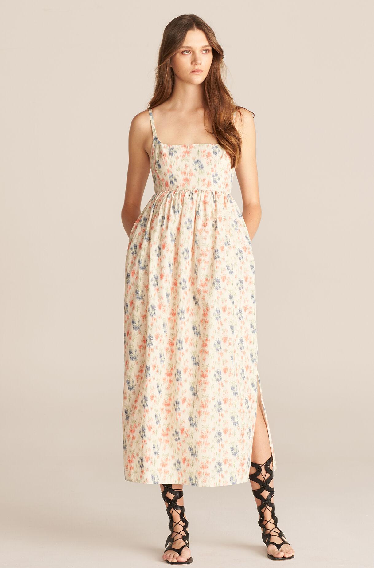 spring wedding guest dress in warm tones