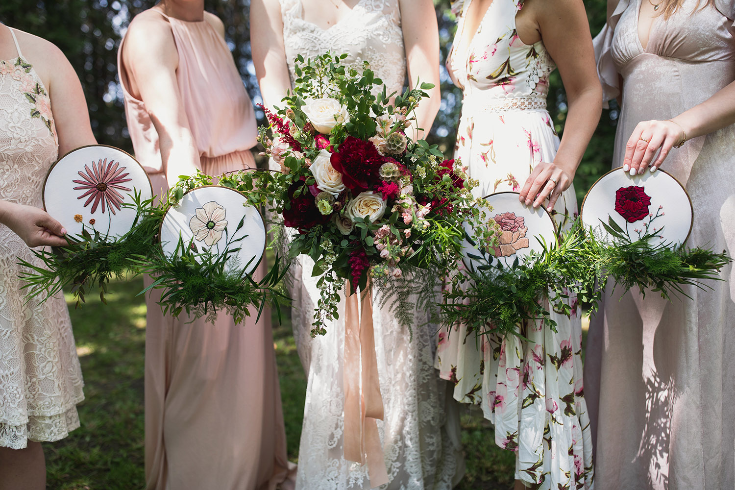 bridesmaids carrying embroidery hoops