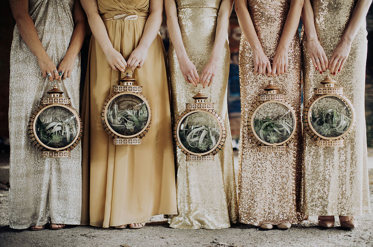 bridesmaids carrying succulents in lanterns