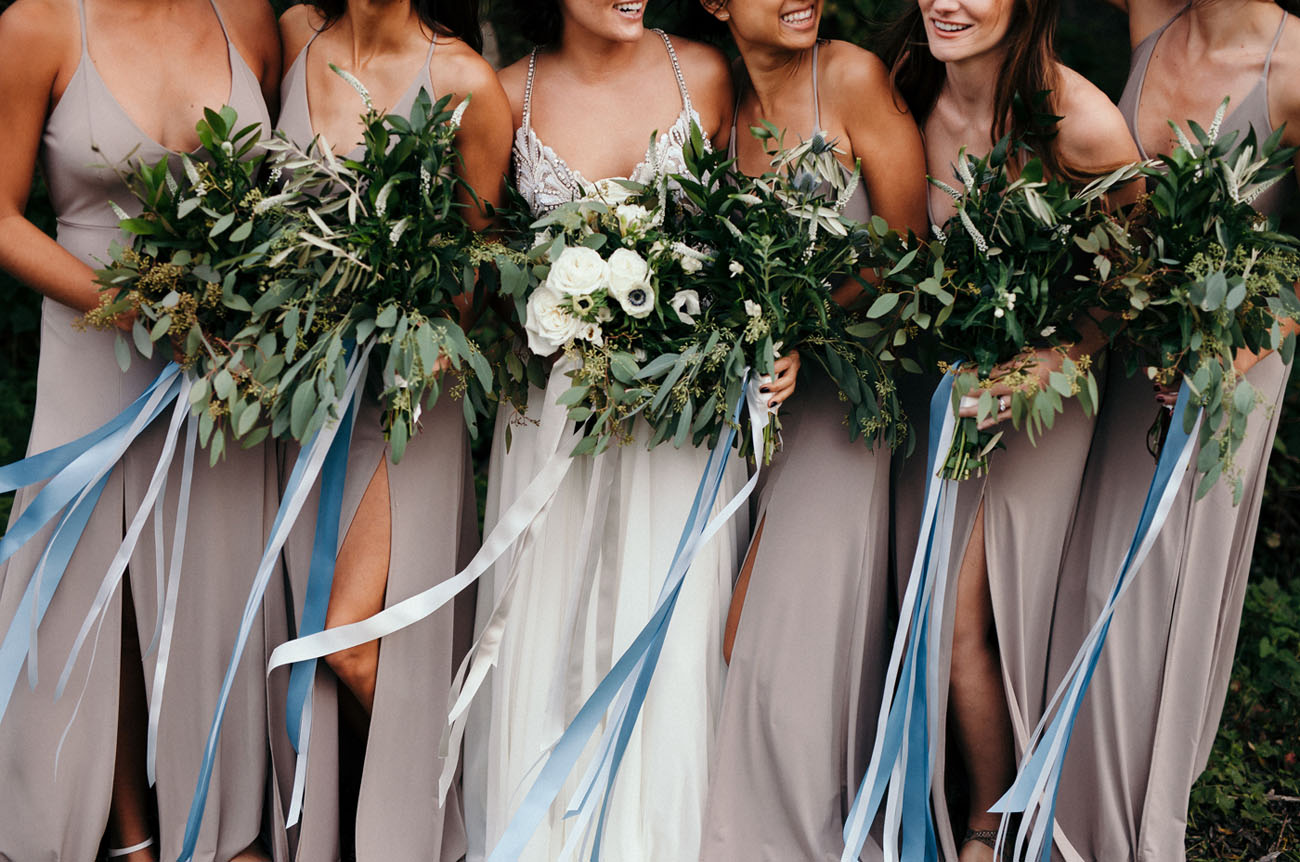 bridesmaids carrying greenery bouquets