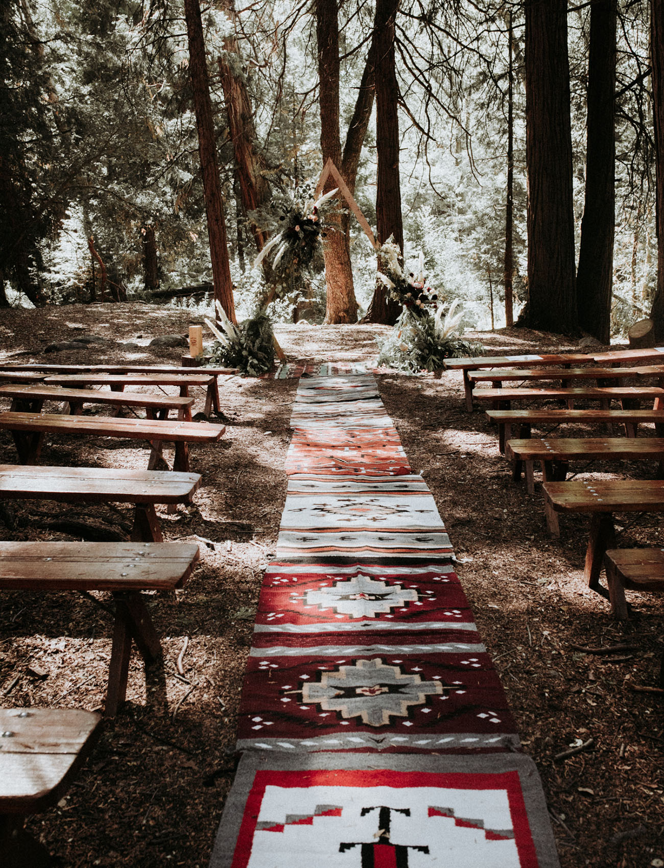 boho rug ceremony aisle