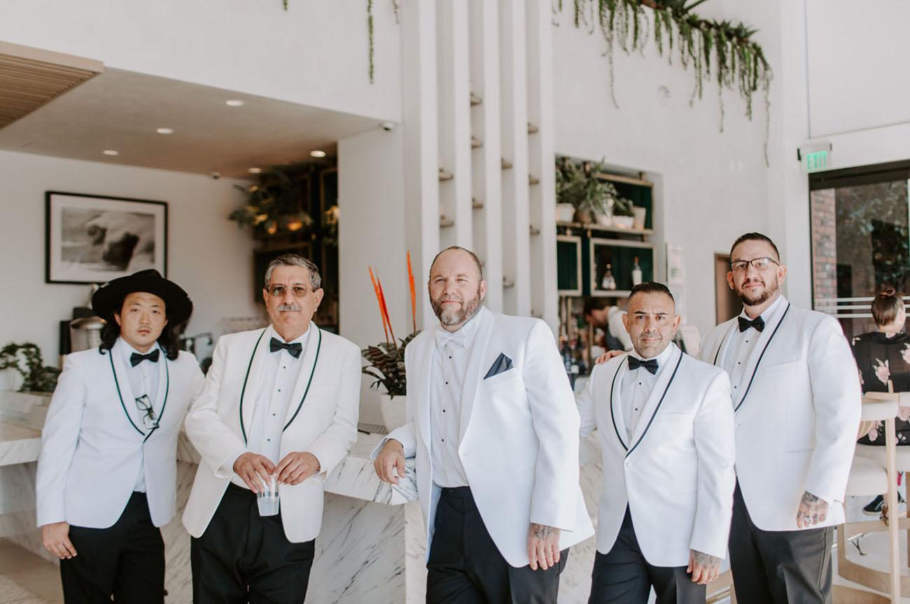 white tux groomsmen