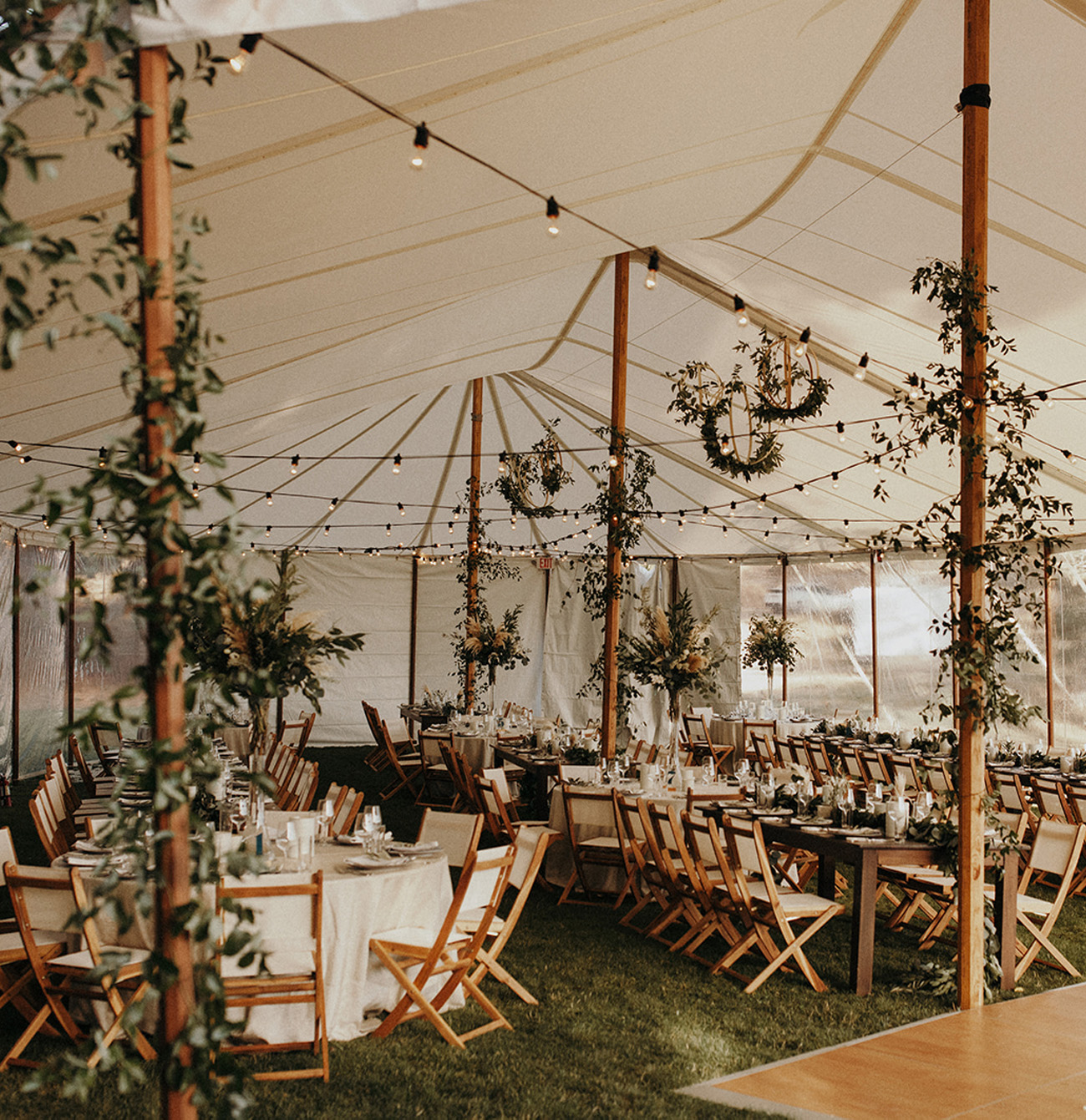 Rustic Wedding Tent with Tons of Greenery