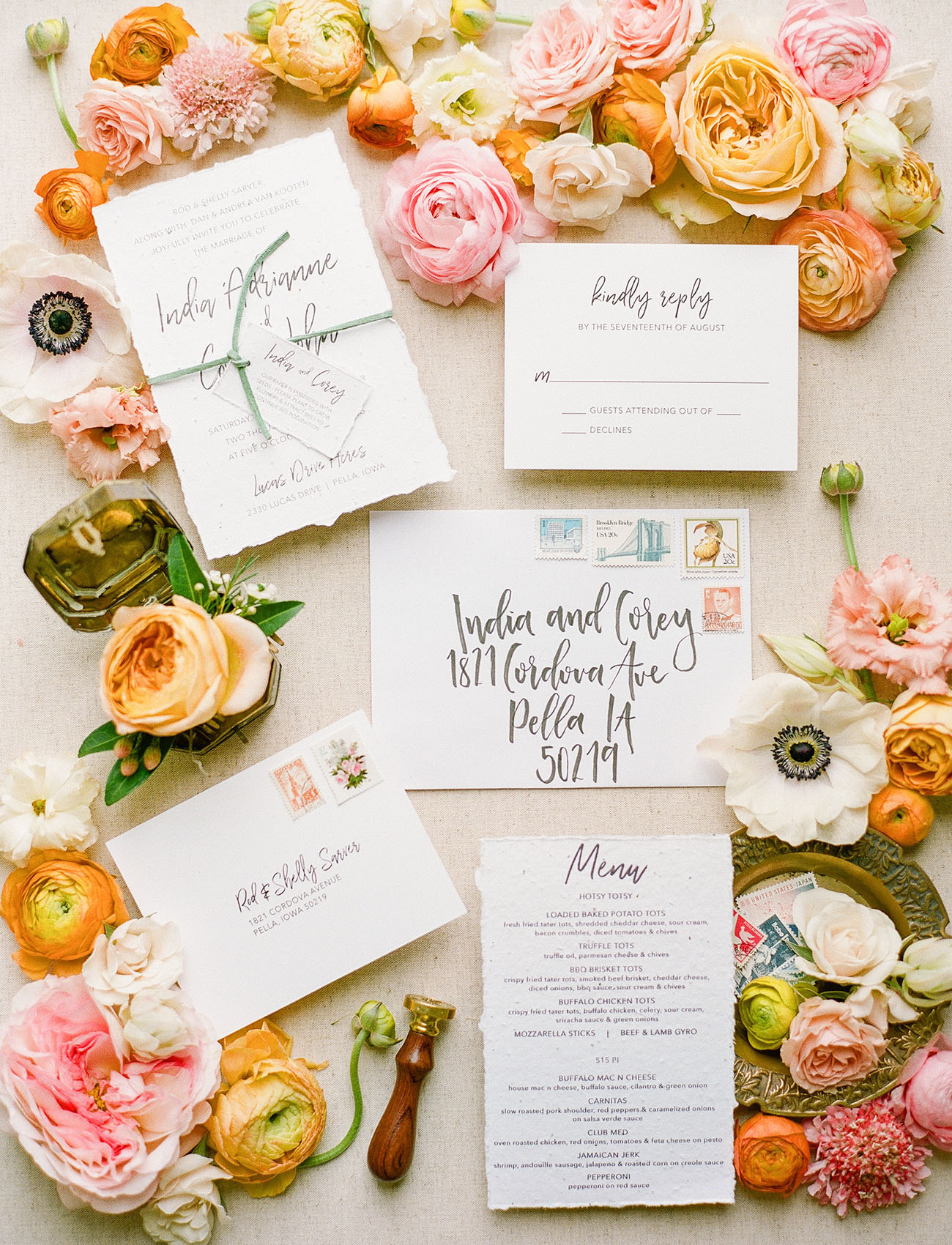 floral invitation flat lay