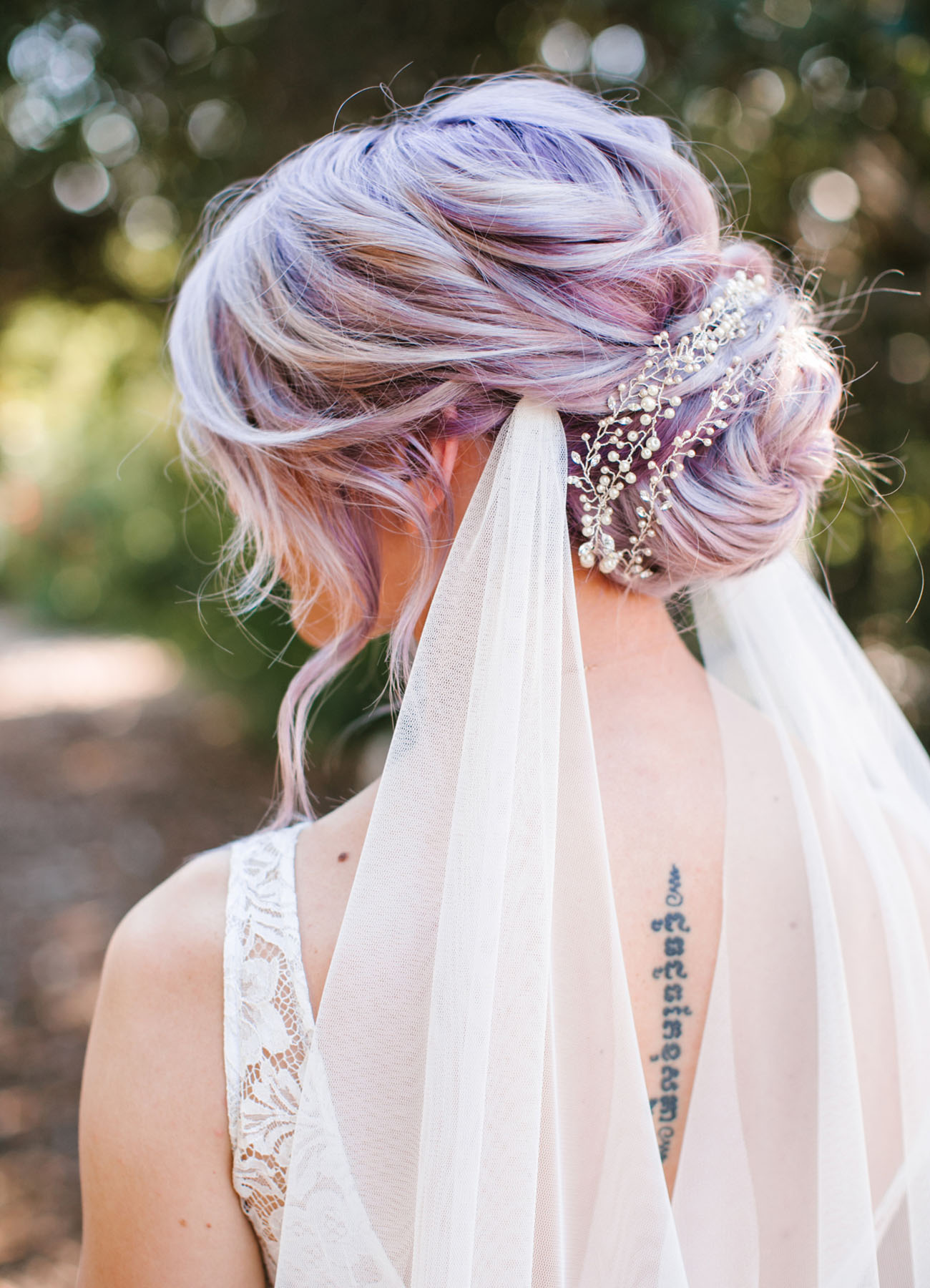 boho chic messy bun hairstyles for brides
