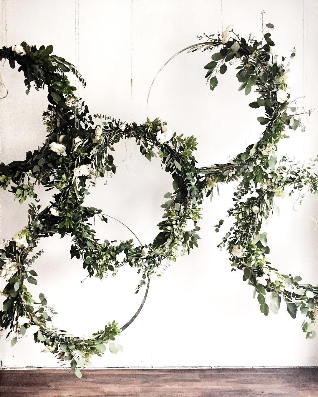 DIY wedding backdrops with greenery covered hoops with florals