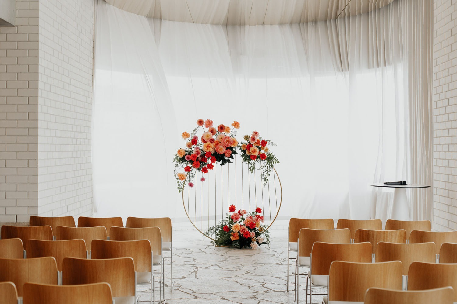 DIY wedding backdrop made of a gold metallic circle grid with florals on it