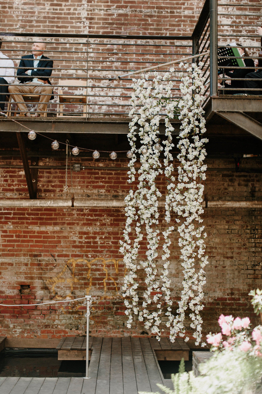 hanging florals DIY wedding backdrop idea