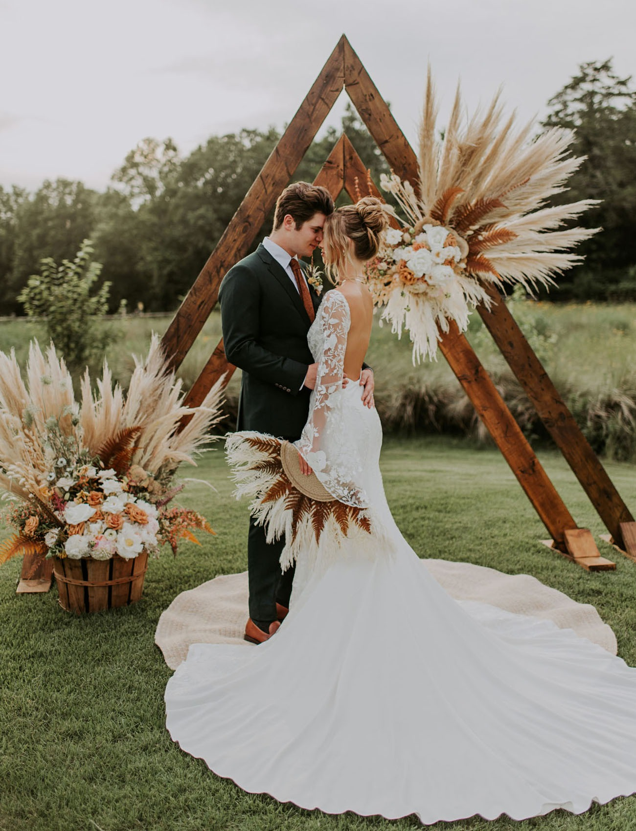 double wooden arch DIY wedding backdrop with pampas grass
