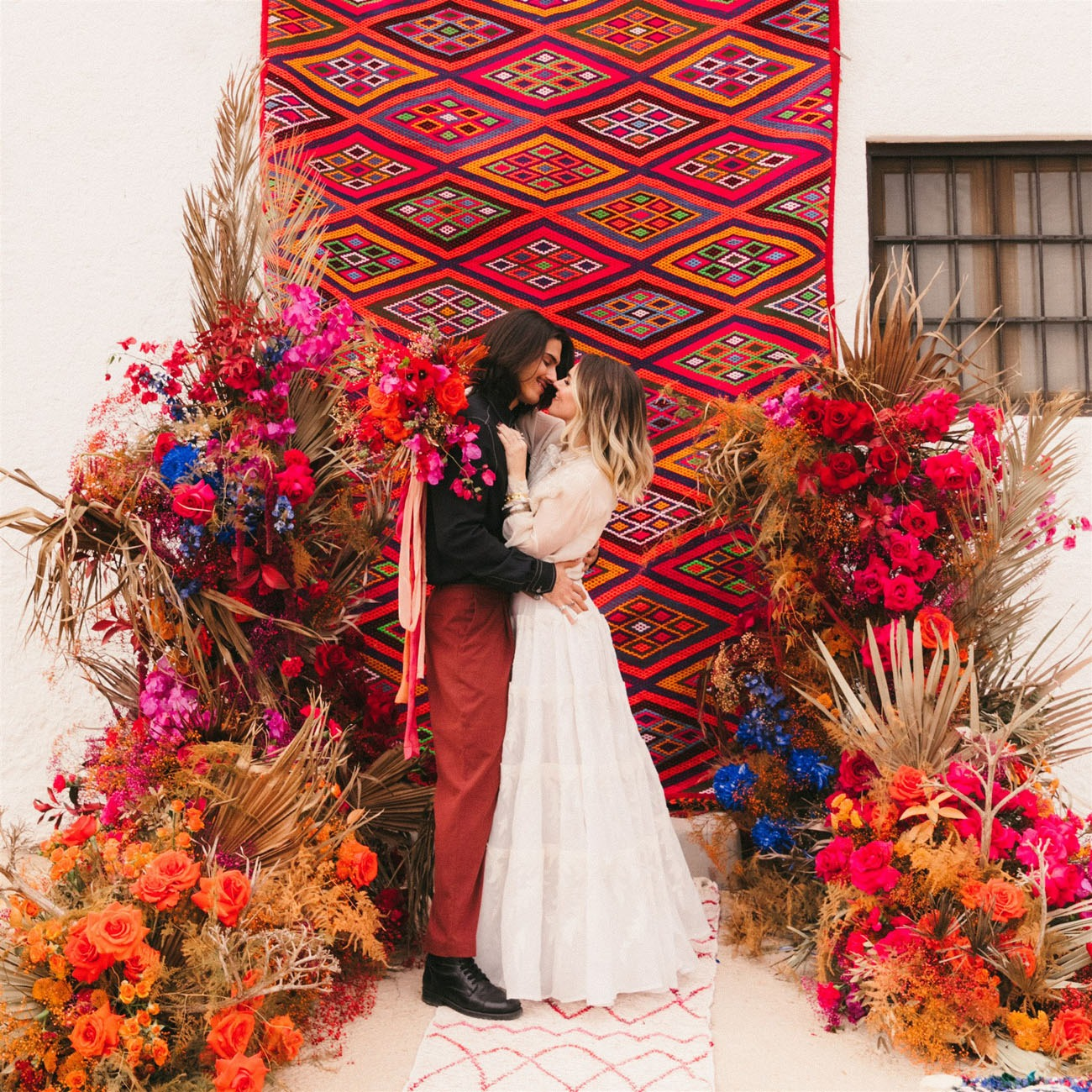 vibrant red tapestry rug wedding backdrop