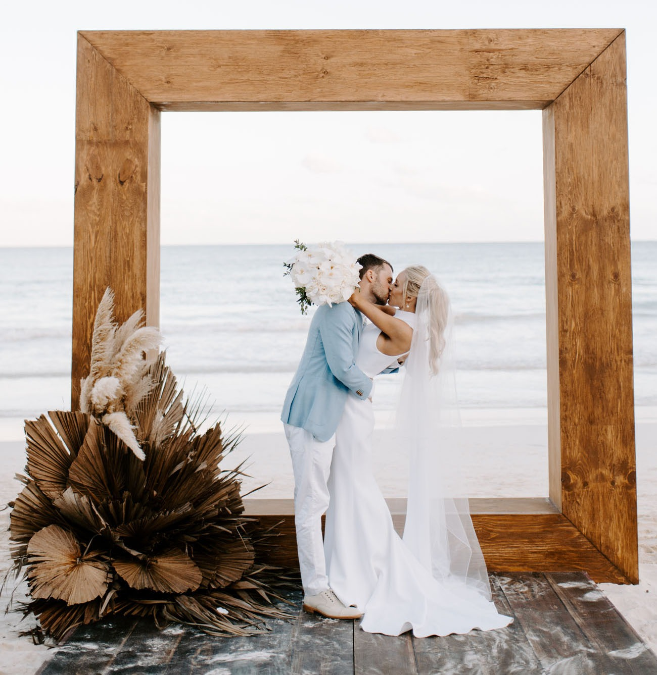 chunky wooden square DIY wedding backdrops for a beach wedding