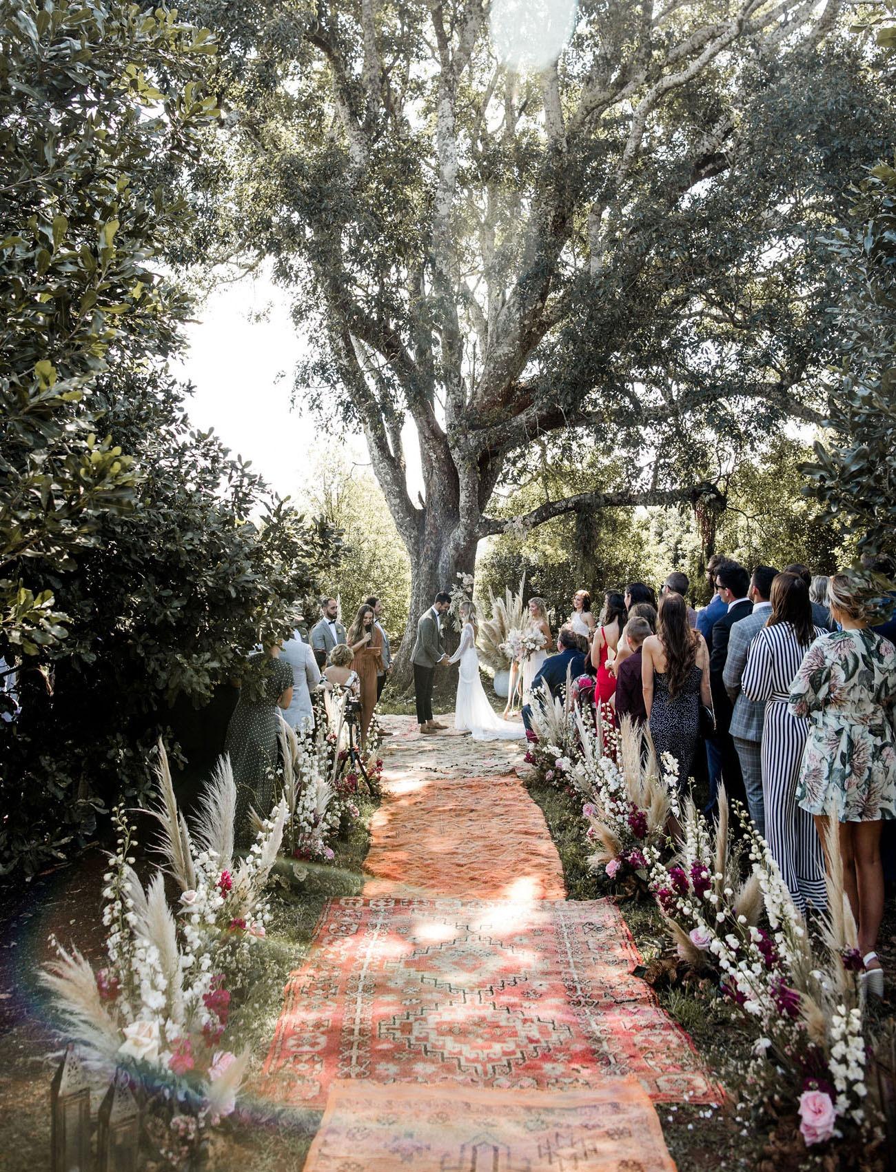 large tree serving as a DIY wedding backdrop for a backyard wedding