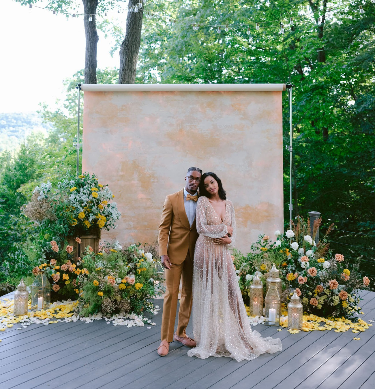 DIY wedding backdrop made of painted seamless photo paper