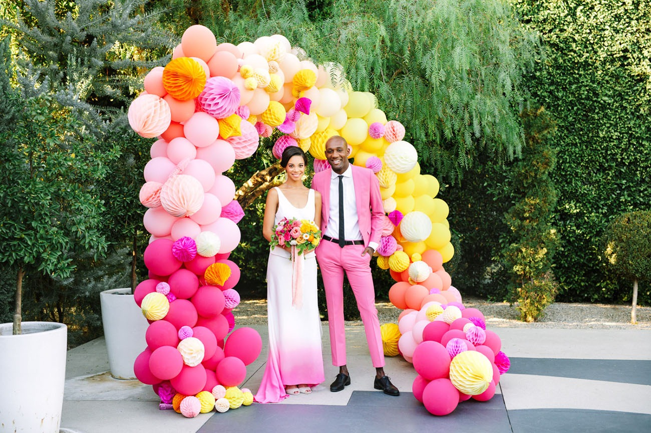 colorful pink and yellow balloon arch wedding backdrops
