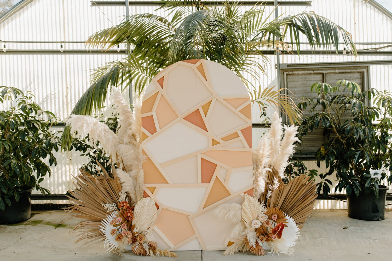 geometric pastel wooden arch DIY wedding backdrop idea
