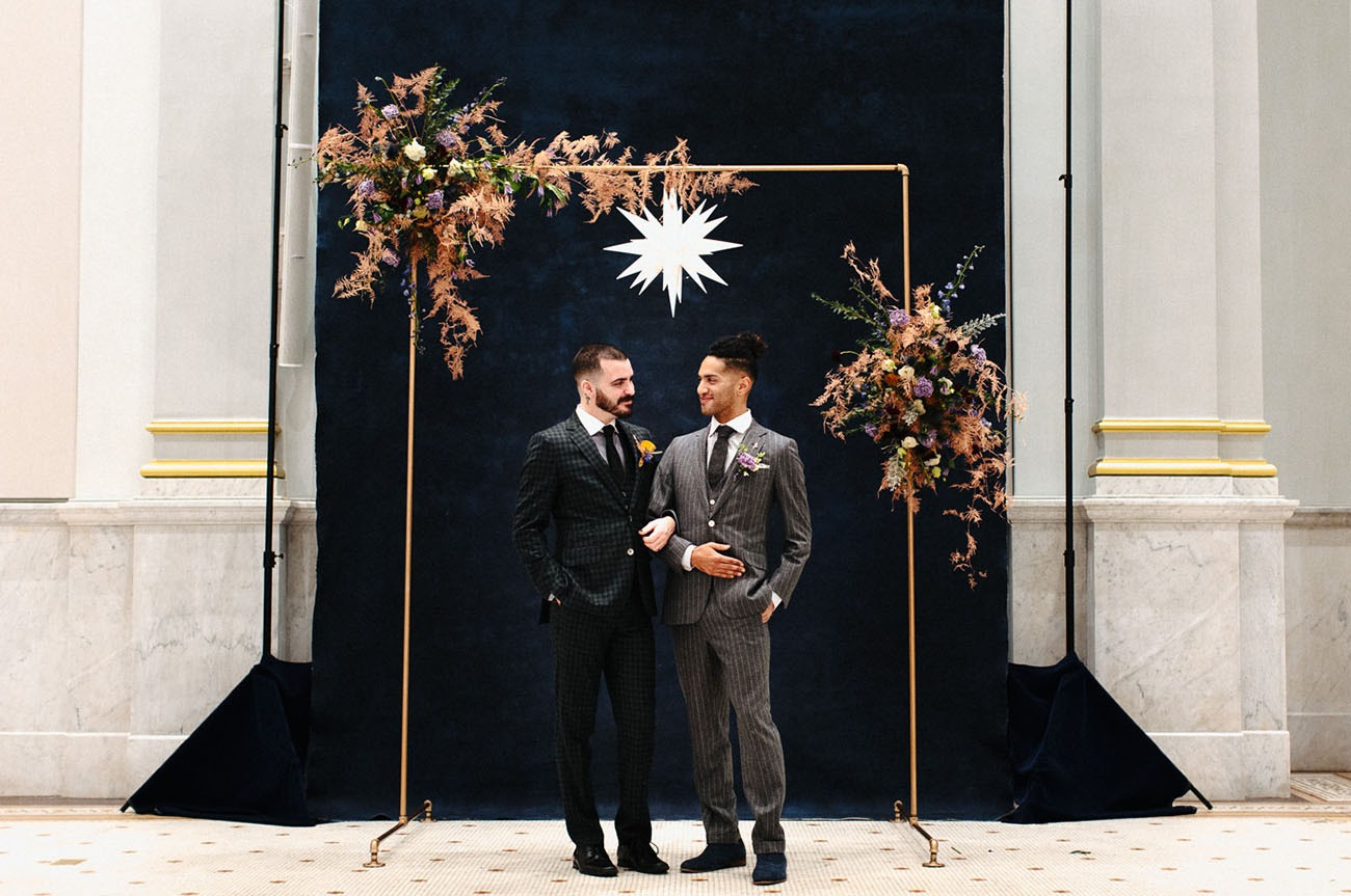 copper pipe wedding backdrop arbor with celestial inspired decor
