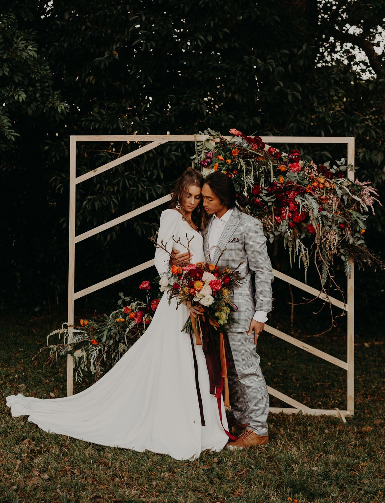 geometric wooden DIY wedding backdrops decorated with flowers