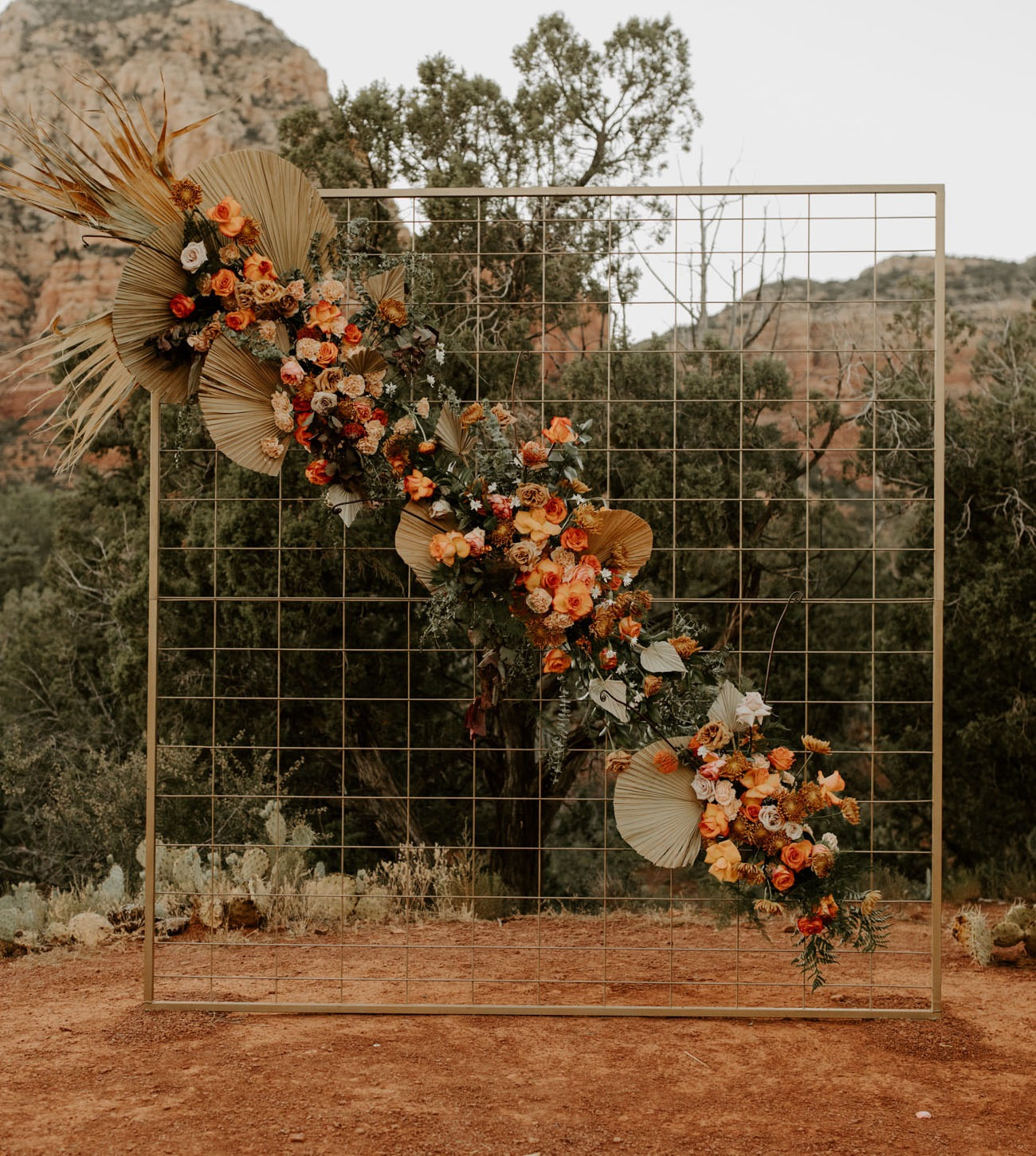 gold grid wedding backdrop with diagonal florals