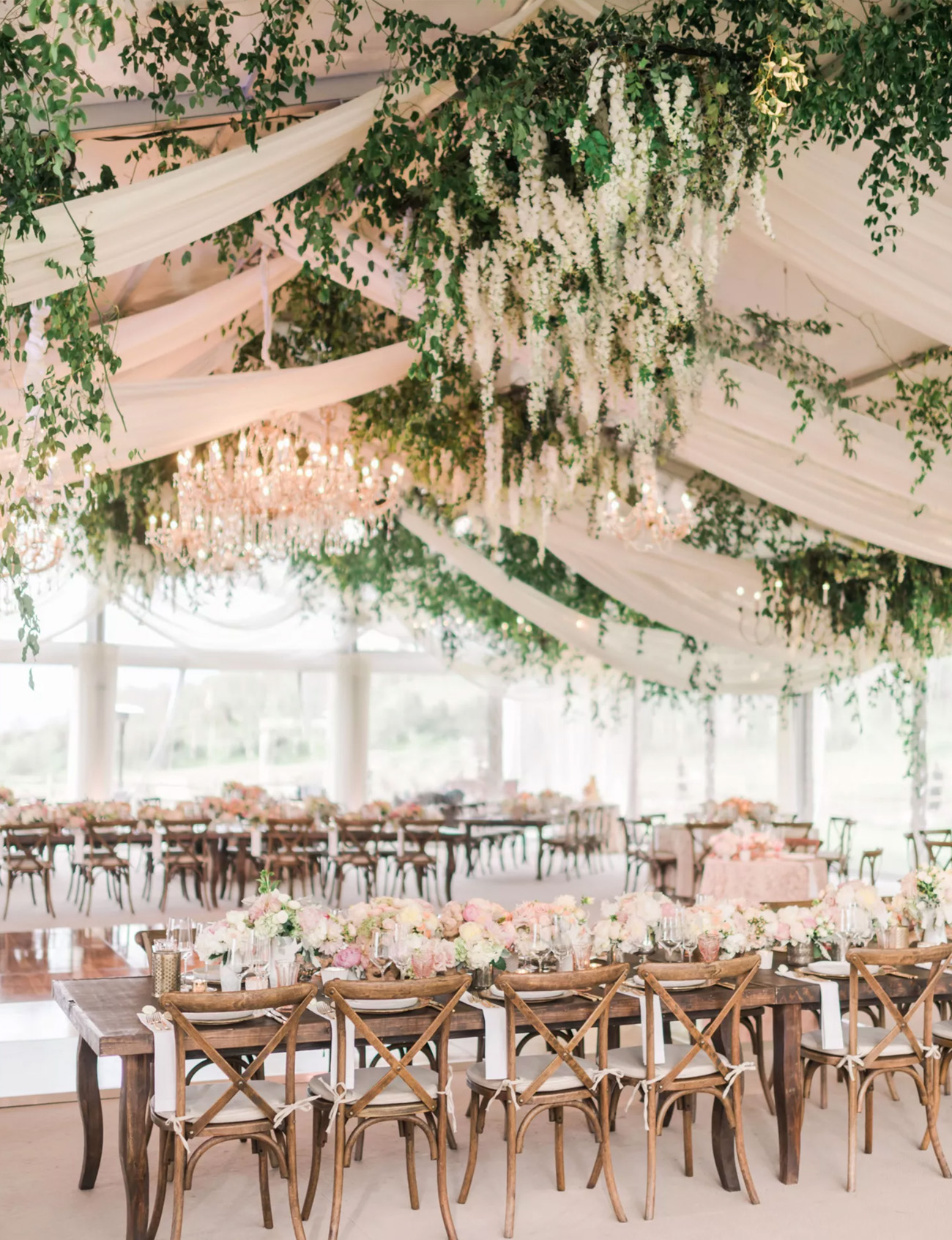 tent wedding with fabric and flowers on the ceiling