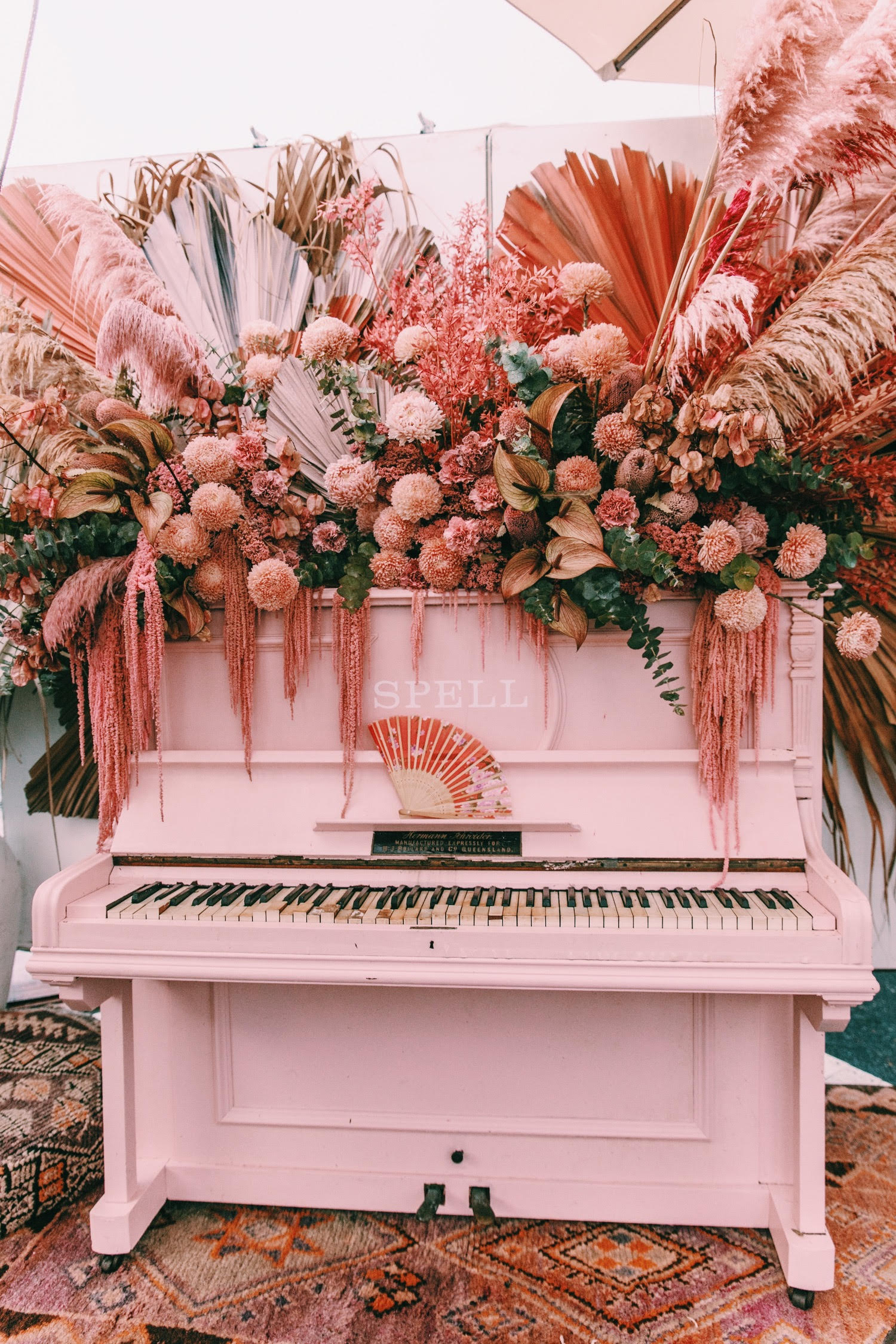 pink floral piano installation